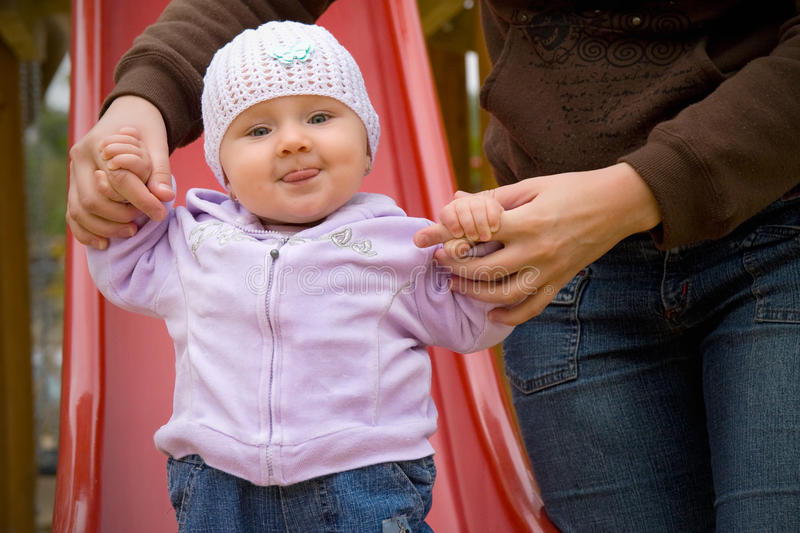 Helping hands for baby stock photos