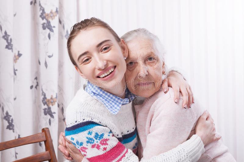 Helping hands, care for the elderly concept. Senior and caregiver holding hands at home. Helping hands, care for the elderly concept closeup. Senior and stock images