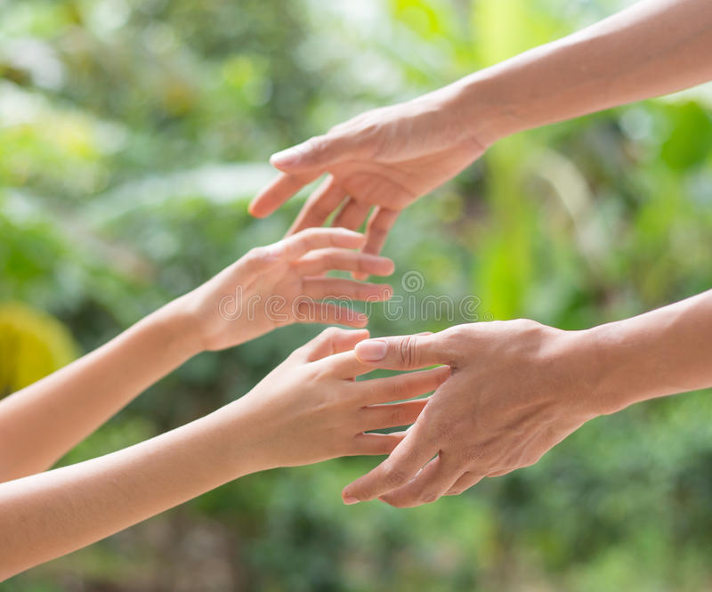 Helping hands stock photography
