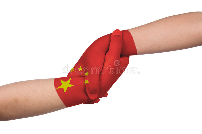 Helping hands of two children with China flag painted royalty free stock photography