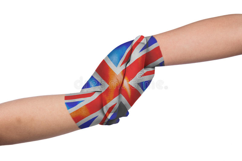 Helping hands of two children with United Kingdom flag painted royalty free stock photos