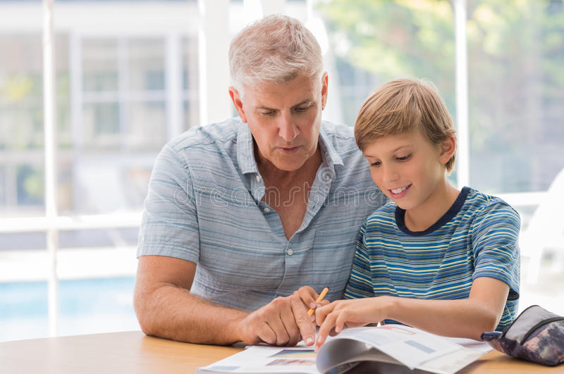Helping with homework royalty free stock photography