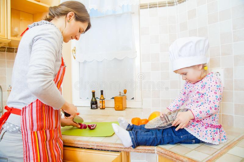 Helping my mother with my little hands stock image