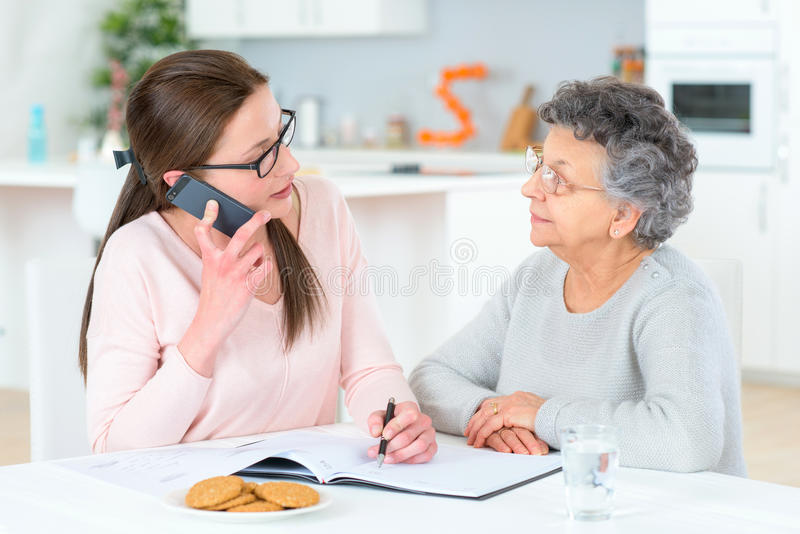 Helping old lady sort finances royalty free stock images
