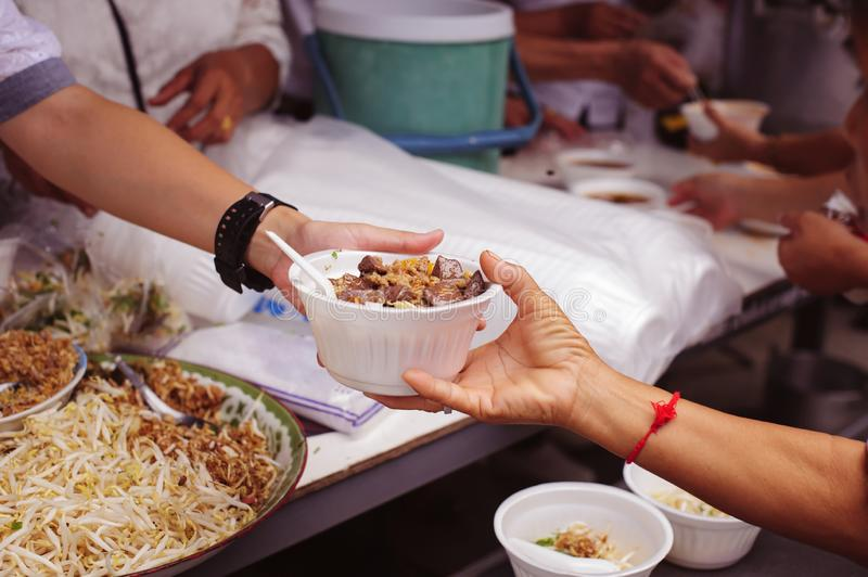Helping people by donating food: The concept of feeding stock photo