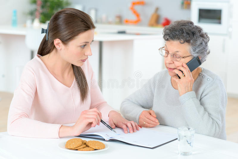 Helping senior lady with finances royalty free stock photo