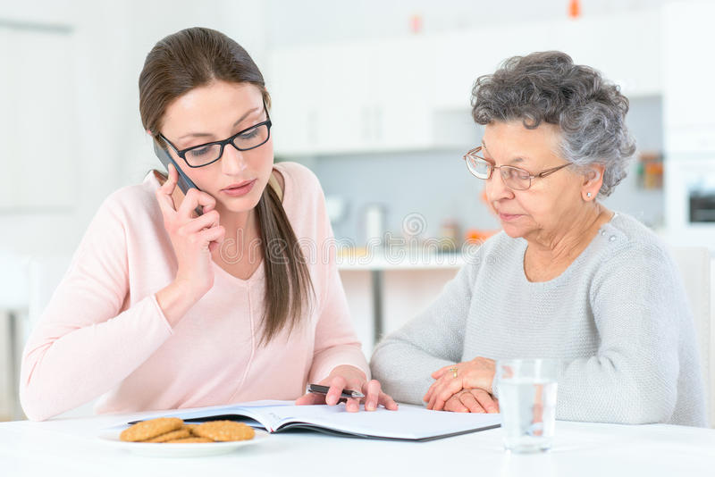 Helping senior lady with finances royalty free stock images