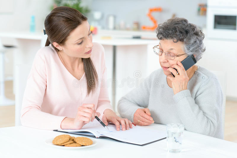 Helping senior lady with finances royalty free stock photos