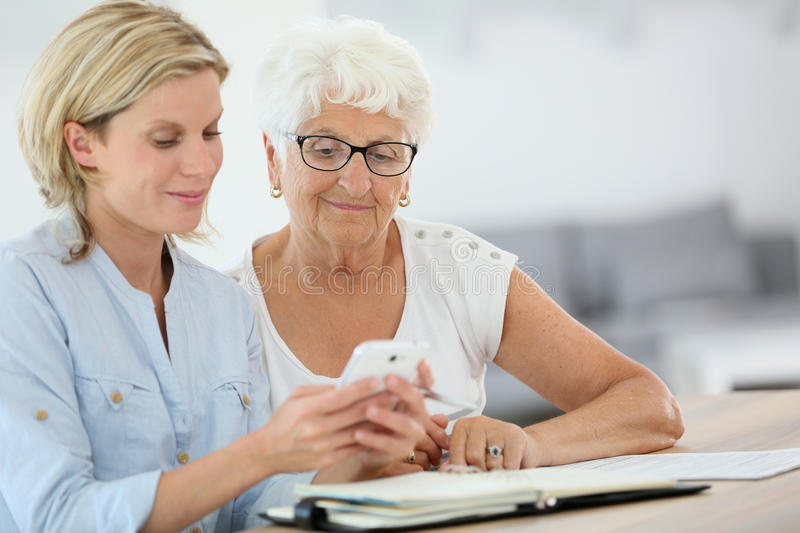 Helping seniors in everyday life stock image