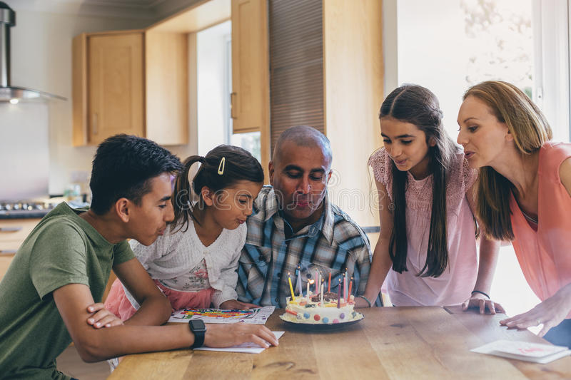 Helping to blow out the candles! royalty free stock images
