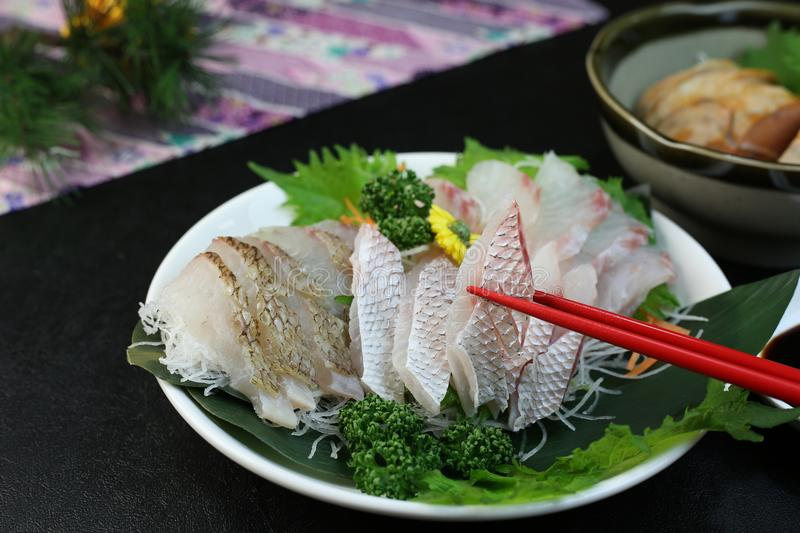 A plate of assorted sashimi. It is a helping of various kinds of dishes of the sashimi of the sea bream stock photo