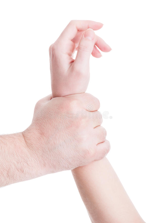Helpless woman arm grab by man hand royalty free stock photography