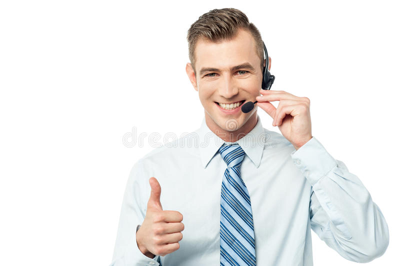 Helpline operator showing thumbs up royalty free stock photography