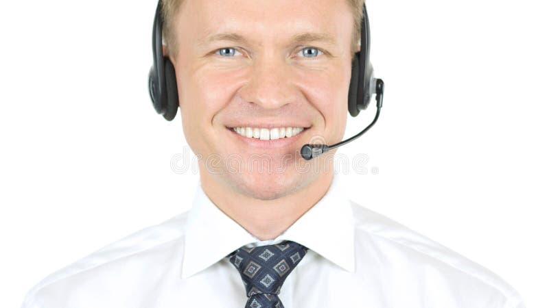 Helpline som ler operatören med hörlurar fotografering för bildbyråer