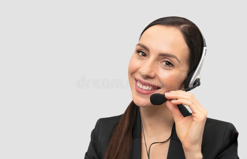 Helplineoperatör med hörlurar med mikrofon royaltyfri bild