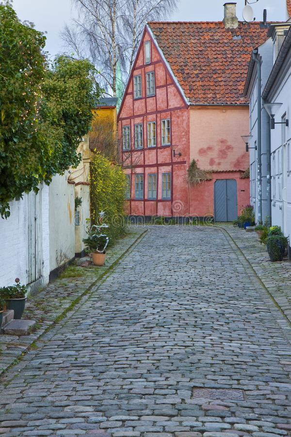 Helsingor city in winter with typical brick and wooden houses and stone road. It`s the place where William Shakespeare set the. Hamlet near Kronborg place. The royalty free stock image