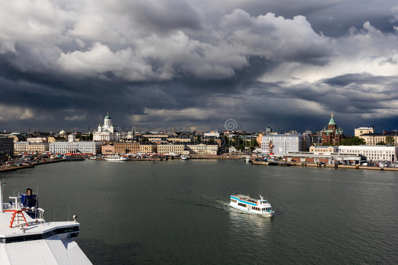 Helsinki. Seen from the sea and a ship leaving the city before the storm royalty free stock photography