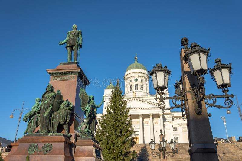 Helsinki Cathedral with a monument to Alexander II and streetlights.  stock photography