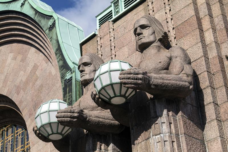 Art Deco Statues - Helsinki - Finland. Helsinki - Finland. Art Deco figures at the main entrance to the central Railway Station. The station is used by over 200 royalty free stock photography
