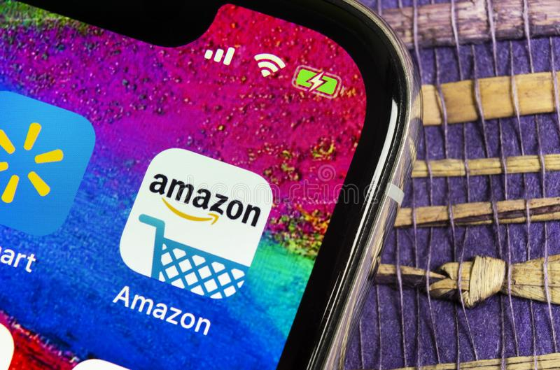 Amazon shopping application icon on Apple iPhone X screen close-up. Amazon shopping app icon. Amazon mobile application. Social me. Helsinki, Finland, February royalty free stock photography