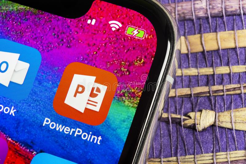 Microsoft office Powerpoint application icon on Apple iPhone X screen close-up. PowerPoint app icon. Microsoft Power Point applica. Helsinki, Finland, February royalty free stock photo