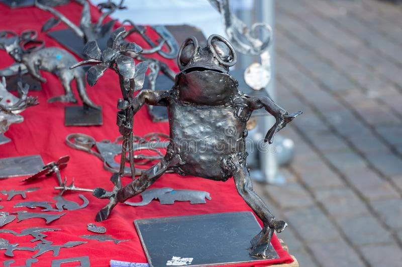 Helsinki / Finland 07.20.2019: hand made frog scrap metal stock photo