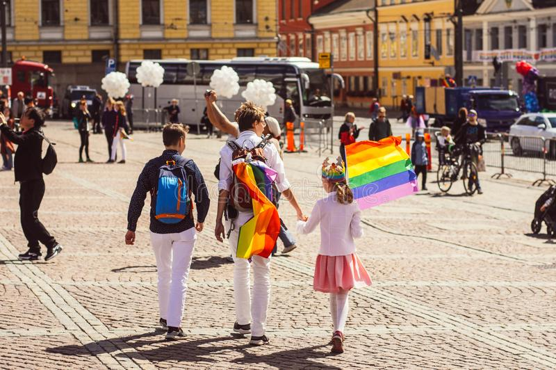 Helsinki, Finland - June 30, 2018: Two women with child with rainbow flag on Helsinki pride festival on Senate square royalty free stock photos