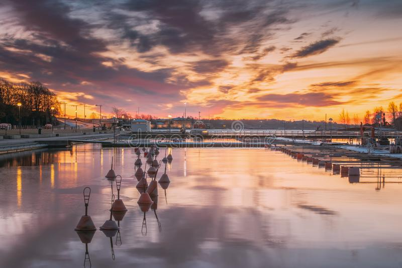 Helsinki, Finland. Landscape With City Pier, Jetty At Winter Sunrise Or Sunset Time. Tranquil Sea Water Surface At Early stock image