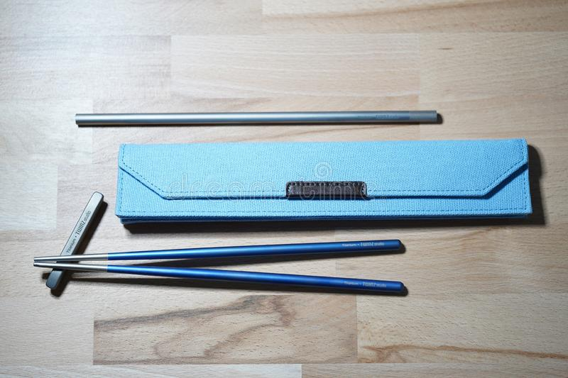 Helsinki, Finland - March 27, 2019: Chopsticks and straw made of titanium for sustainable purposes and not using plastic ones. stock images