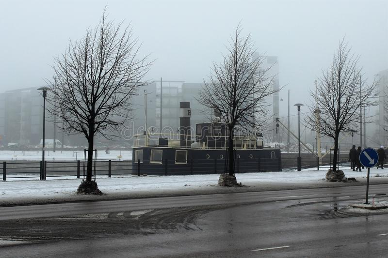 Helsinki, Finland, March 2012. Foggy spring morning in the seaport. royalty free stock photo