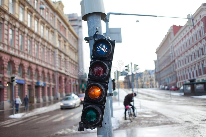 HELSINKI, FINLAND - MARCH 20, 2011: Traffic light with a signal for the bike. Ecological transport in the city. royalty free stock images