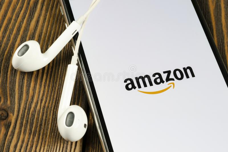Amazon shopping application icon on Apple iPhone X screen close-up. Amazon shopping app icon. Amazon mobile application. Social me. Helsinki, Finland, May 4 stock photography