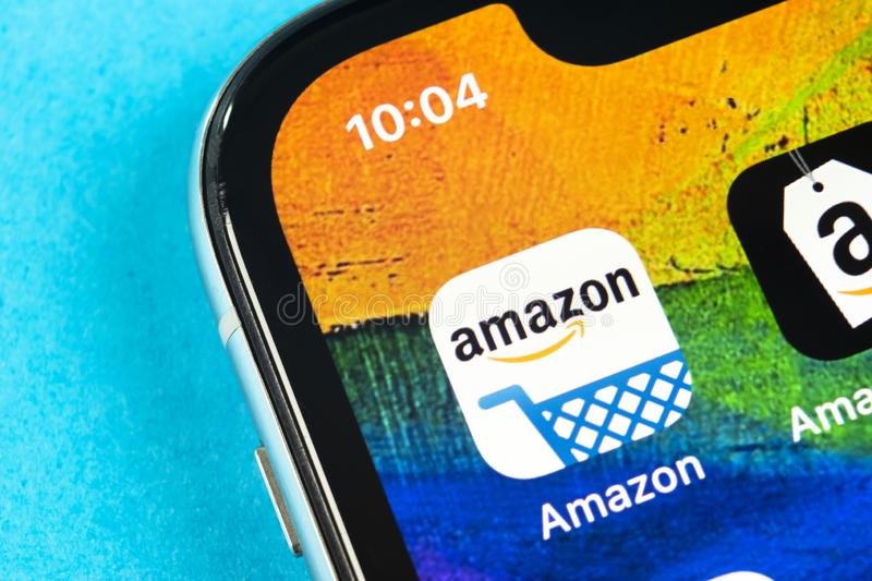 Amazon shopping application icon on Apple iPhone X screen close-up. Amazon shopping app icon. Amazon mobile application. Social me. Helsinki, Finland, May 4 royalty free stock photo