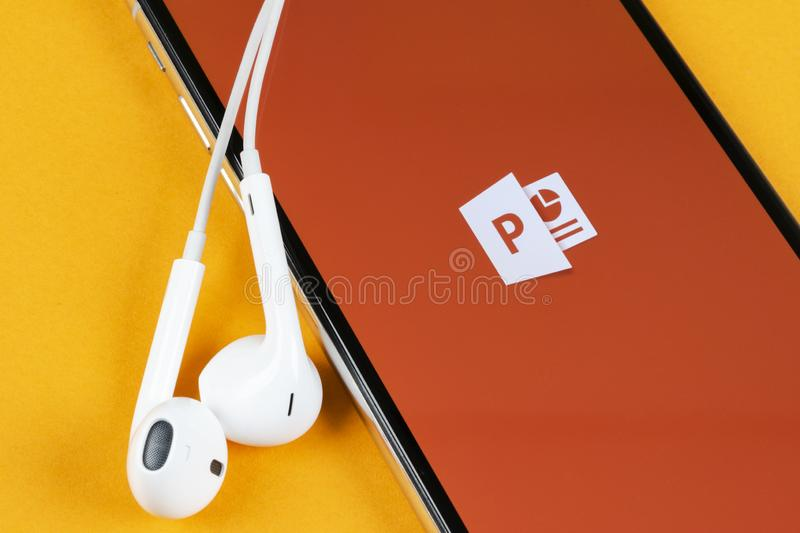 Microsoft office Powerpoint application icon on Apple iPhone X screen close-up. PowerPoint app icon. Microsoft Power Point applica. Helsinki, Finland, May 4 royalty free stock image