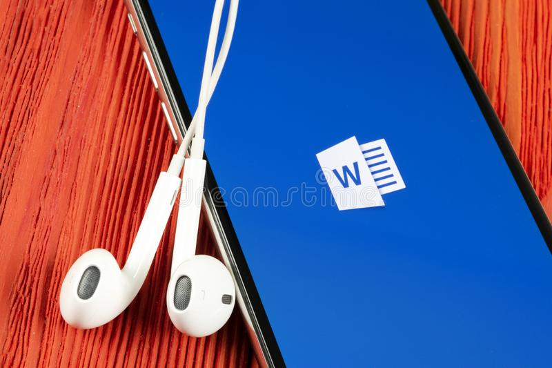 Microsoft Word application icon on Apple iPhone X screen close-up. Microsoft office word icon. Microsoft office on mobile phone. S stock photo