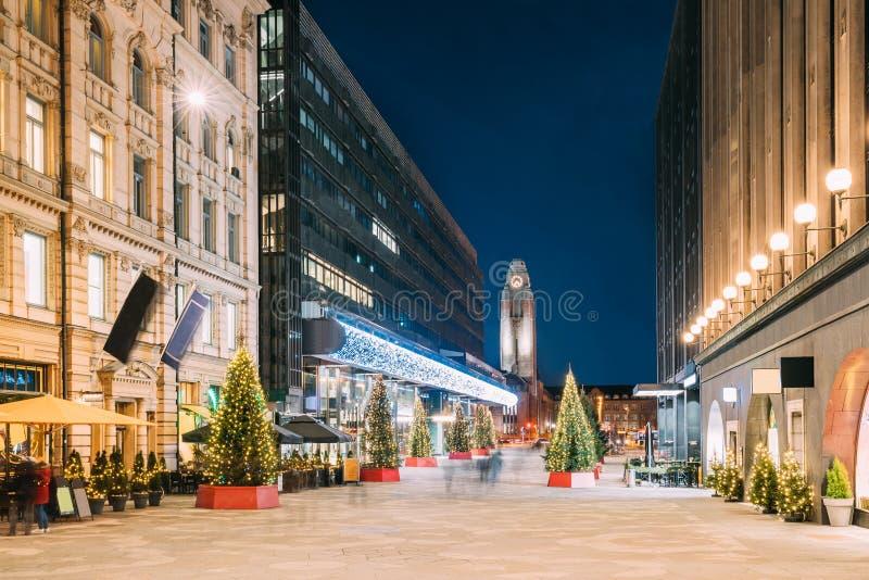 Helsinki, Finland. Night View Of Keskuskatu Street In Evening Christmas New Year Xmas Festive Illumination. Shopping. Mall And Helsinki Central Railway Station royalty free stock images