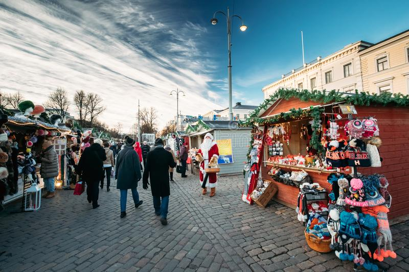 Helsinki, Finland. Santa Claus Giving Candy At Christmas Xmas Market stock images