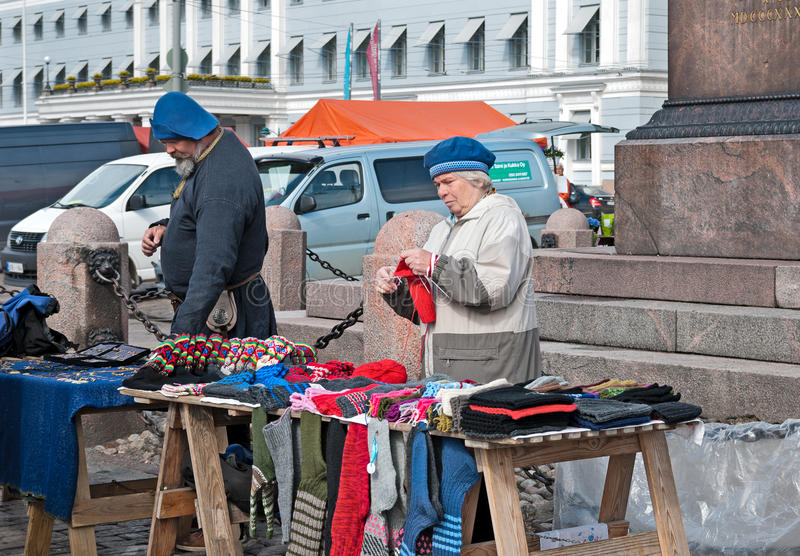 Helsinki. Finland. Woman knits on The Market Square royalty free stock image