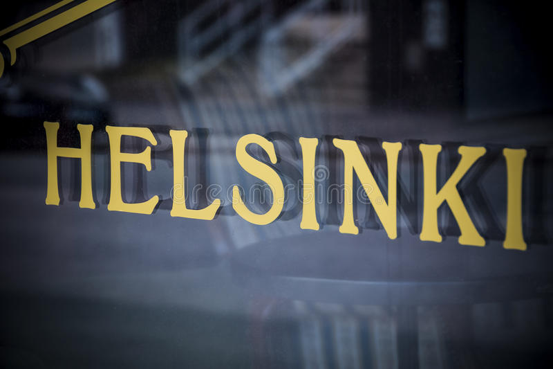 Helsinki golden sign in window in the Finnish capital. Finland capital spelled out on upmarket store frontage stock image
