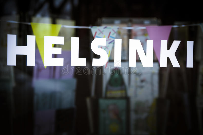 Helsinki sign in store window in the Finnish capital. Finland capital spelled out on store frontage royalty free stock image