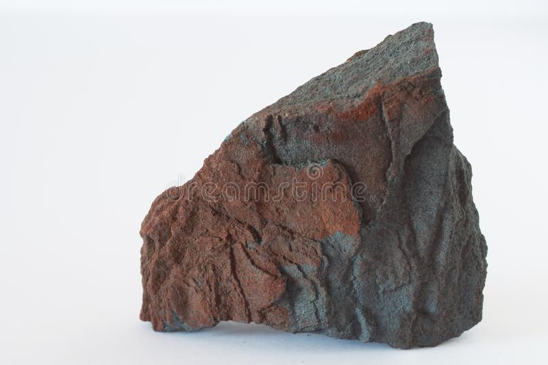 Hematite or haematite mineral also iron ore on white background. Hematite or haematite mineral also iron ore, oxides of iron from the Ural mountains region of stock photos