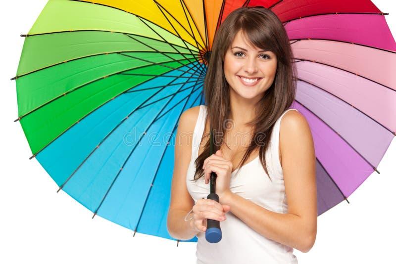 Hembra bajo el paraguas foto de archivo libre de regalías