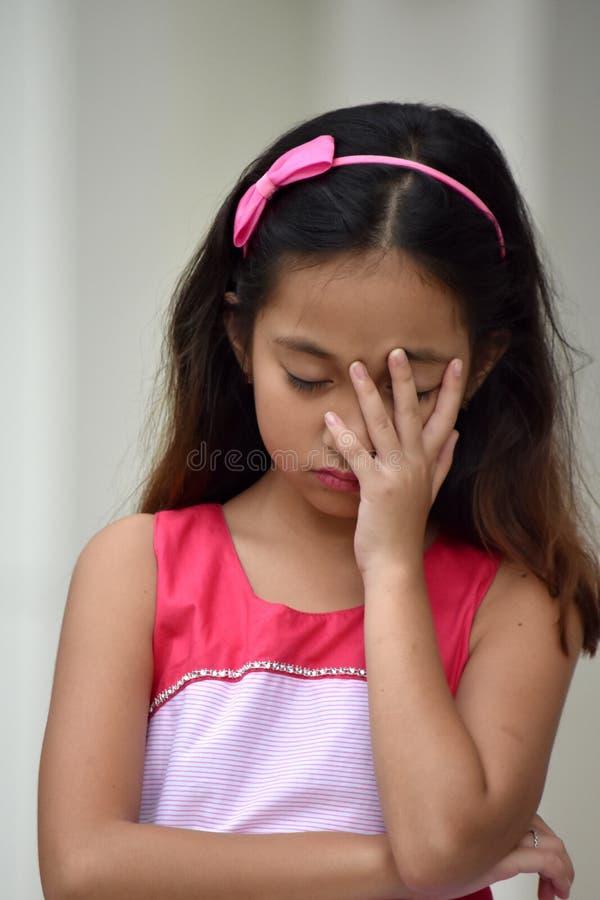 Hembra y tristeza de la minor?a foto de archivo libre de regalías