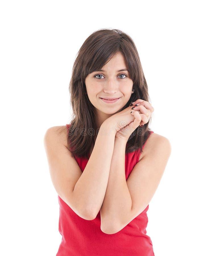 Hemd-Holdinghände der Mädchenabnutzung rote auf Kinn stockfotografie