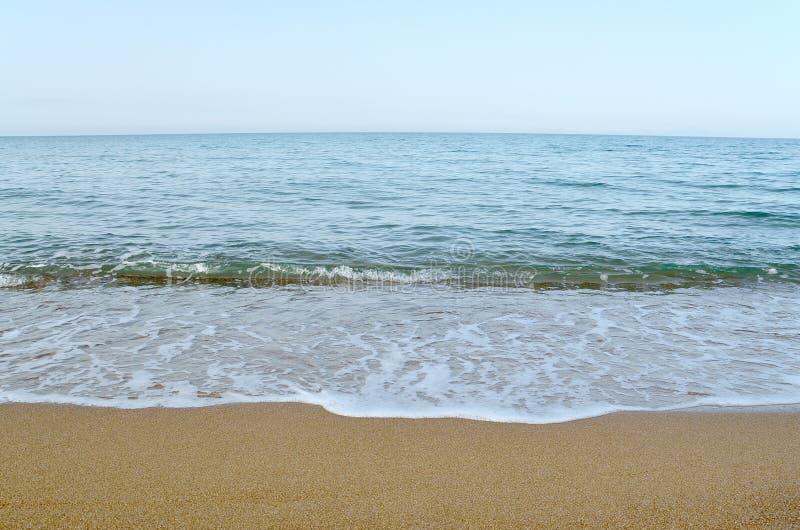 Hemel, overzees en zand stock foto