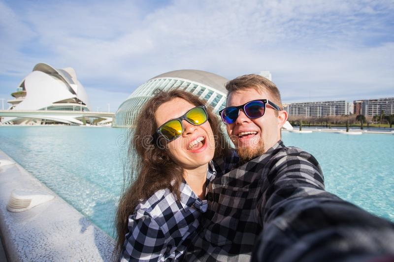 Valencia, Spain, January, 02, 2018, Happy couple makes selfie on the background of the Hemisferic building in City of stock photos