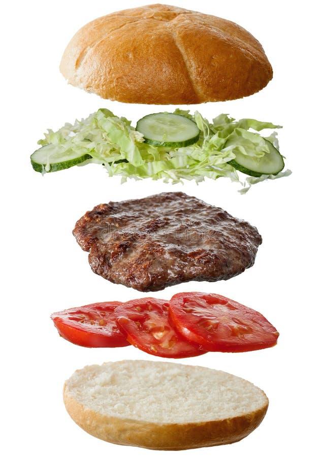hemlagade ingredienser för hamburgare arkivbild