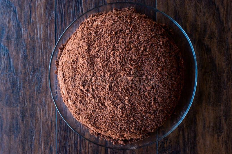 Hemlagade Mink Mole Hole Cake med den chokladkexet, bananen och gräddost royaltyfri bild