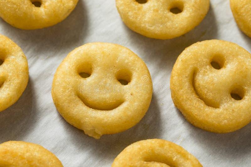 Hemlagade Smiley Face French Fries arkivfoto