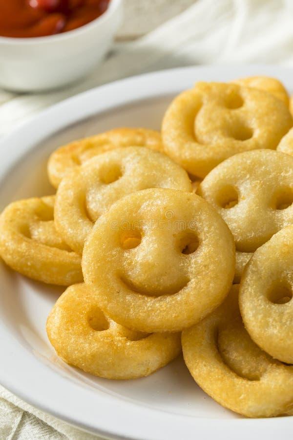 Hemlagade Smiley Face French Fries royaltyfri foto